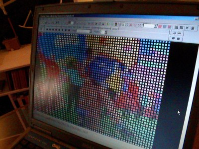 Laptop running software to convert user-generated MMS into a format which can be displayed by an LED wall